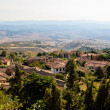 Постер, плакат: View of the Roofs and Landscape of a Small Town Volterra in Tusc