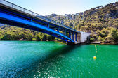 National Park Krka and Blue Bridge over the River near Town of S — Stock Photo