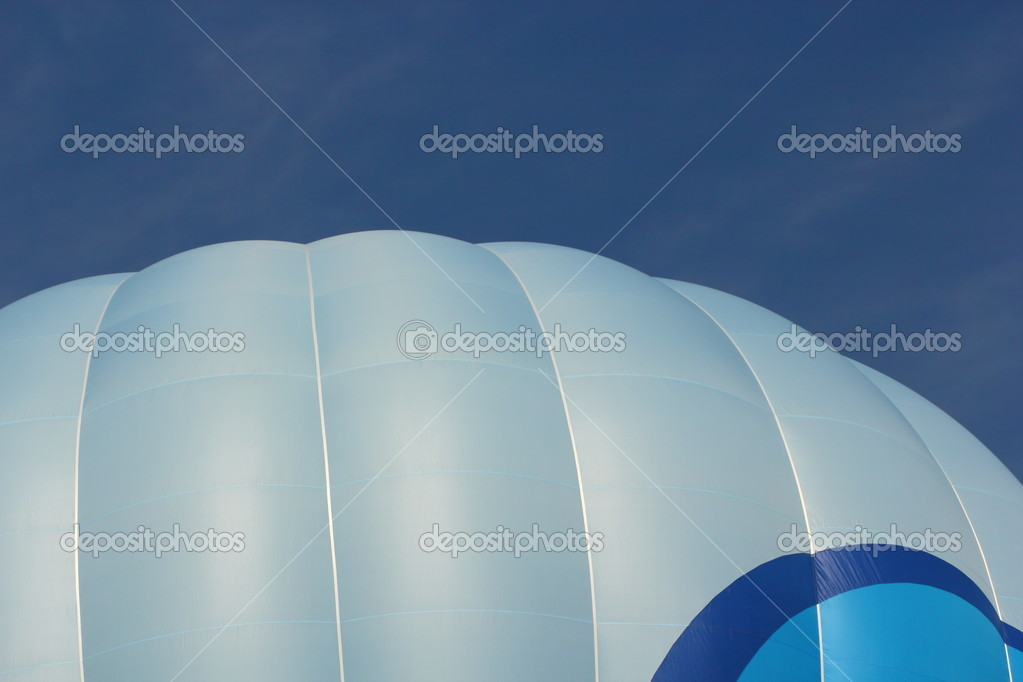 Top of hot air balloon over blue sky — Stock Photo #11246577
