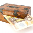 Stock Photo: Money partly in wooden box