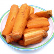 Boiled carrots on dish - Stock Photo