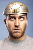 Portrait of a man with a colander on his head — Stock Photo