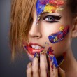 Beautiful young girl with paint on his face — Stock Photo