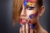 Beautiful young girl with paint on his face — Foto Stock