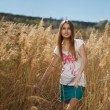 Beautiful girl in the reeds — Stock Photo