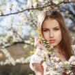 Beautiful girl in the branches — Stock Photo