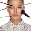 Stock Photo: Beautiful womwith brushes for make-up