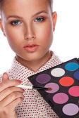 Makeup artist applying blusher — Stock Photo