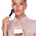 A beautiful young girl with makeup brush — Stock Photo #11618420