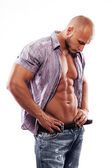 Male muscular model with open shirt — Stock Photo
