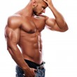 A young man with a beautiful physique thinking — Stock Photo