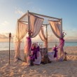 Romantic Wedding Table on Sandy Tropical Caribbean Beach at Suns - Stock Photo