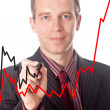 Businessman draws growth charts — Stock Photo