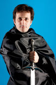 Portrait of man with knight sword — Stock Photo