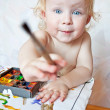 Little girl playing with paint colors — Stock Photo #11451129