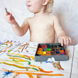 Little girl playing with paint colors — Stock Photo