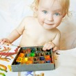 Little girl playing with paint colors — Stock Photo #11451153