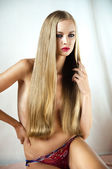 Looking up a beautiful young blonde girl with long hair — Stock Photo