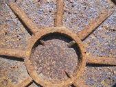 Rusty manhole cover. — Stock Photo