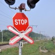 Stock Photo: Sign of stop at railway crossing.