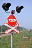The sign of a stop at a railway crossing. — Stock Photo