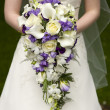 Stock Photo: Bride and wedding bouquet