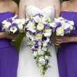 Bride and bridesmaids with wedding bouquets — Stock Photo