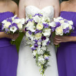 Bride and bridesmaids with wedding bouquets — Stock Photo #11364913
