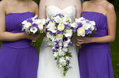 Bride and bridesmaids with wedding bouquets — Stok fotoğraf