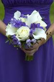 Bridesmaid with wedding bouquet — Stock Photo
