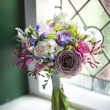 Wedding bouquet near window — Stock Photo #11438052