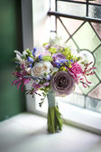 Wedding bouquet near a window — Stock Photo