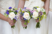 Wedding bouquets held by bridesmaids — Stock Photo