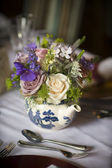 Flower bouquet in a teapot — Stock Photo