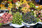 Fresh fruit at the greengrocer — Stock Photo