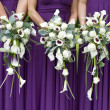 Three bridesmaids holding wedding bouquets — Stock Photo #11822709
