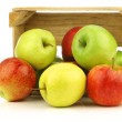 Assorted fresh apples in a wooden crate — Stock Photo #11349314