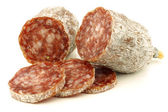 Spicy Italian salami sausage slices — Stock Photo