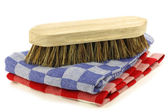 Household brush on two checkered household towels — Stock Photo