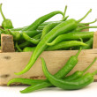 Freshly harvested jalapeno peppers in a wooden crate — Stock Photo #11353752