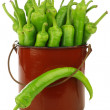 Stock Photo: Freshly harvested jalapeno peppers in an enamel cooking pot