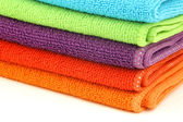 Stacked colorful microfiber cleaning cloths — Stock Photo