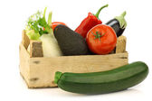Fresh assorted vegetables in a wooden crate — Stock Photo