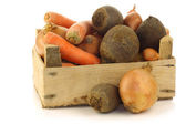 Variety of root vegetables in a wooden crate — Stock Photo
