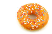 Orange donut with red,white and blue sprinkles — Stock Photo