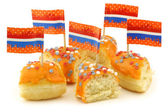 Orange donut pieces with red,white and blue sprinkles and flag toothpicks — Stock Photo