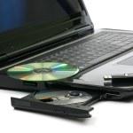 Постер, плакат: Laptop with DVD writer DVD and memory stick