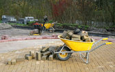 Yellow wheelbarrow — Stockfoto