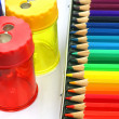 Box of coloring pencils and some pencil sharpeners — Stock Photo #11841436