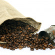 Measuring cup and a burlap bag with coffee beans — Stock Photo